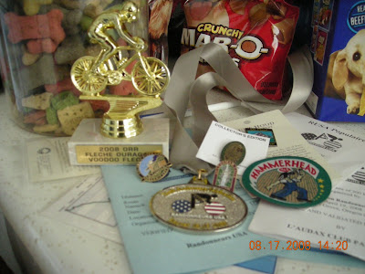 The weekend haul: Vodoo Fleche Trophy, RUSA Anniversary medal, brevet cards and pins