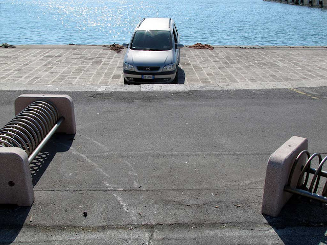 Car sitting on a bench, Porto Mediceo, Livorno