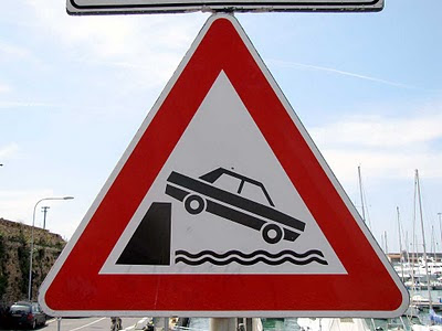 Falling car sign, port of Livorno