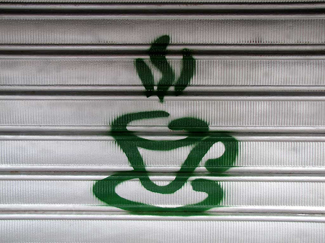 Hot cup of coffee on a shutter, Livorno