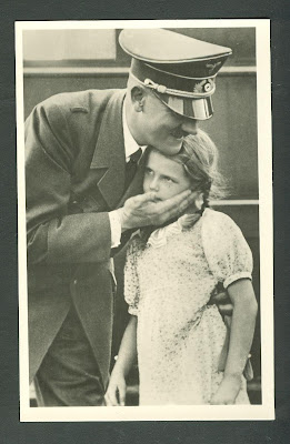 Hitler+hugs+a+young+girl.jpg