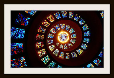 spiral stained glass of the Glory Window at Thanksgiving chapel