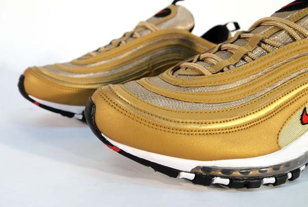 """39e09ad4e6 ... LE Metallic Gold/Varsity Red-Black. Here is a hugely iconic piece of  footwear from Nike with the renowned Air Max 97 edition and the distinctive  """"gold"""" ..."""