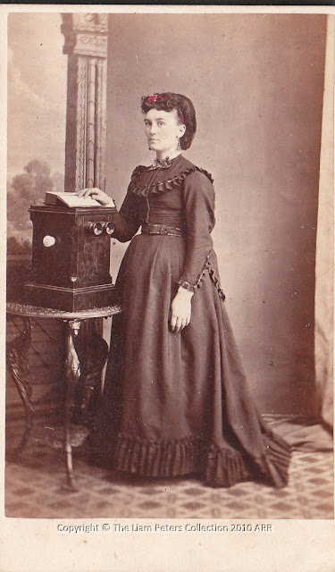Pregnant woman with stereo viewer by T.Nevin 1870s