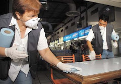 Workers Disinfect Food Tables