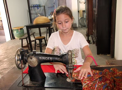 My daughter at the old sewing machine