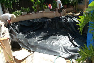 New tarps world used billboard tarps are best containment for Koi pool liners