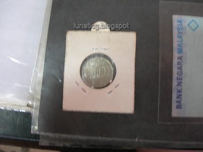Malaysia+1971+10+sen+coin.jpg