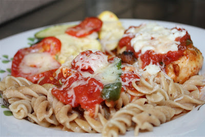plate of pasta with vegetables and chicken parmesan