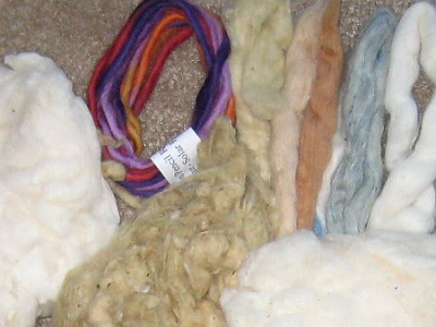 Natural colors plus commercially dyed pencil roving