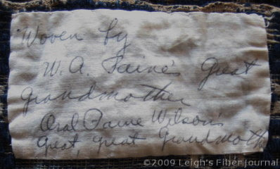 Handwritten label on the coverlet
