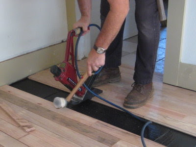 Pneumatic flooring nailer in action
