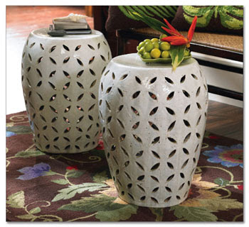 A Pair Of Lattice Garden Stools Combines To Serve As A Coffee Table Grouping