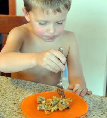 little boy eating Turkey Sausage pot pie
