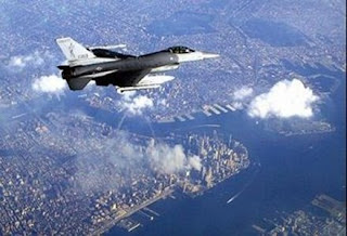 An F-16 Falcon flies over New York, September 12, 2001