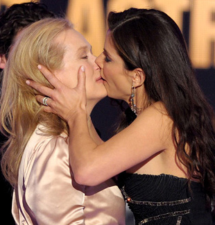 Older women kissing girls