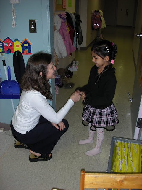 NAMC montessori teacher greets girl montessori prepared environment