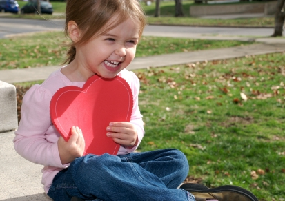 why celebrate valentine's day NAMC montessori classroom student with heart