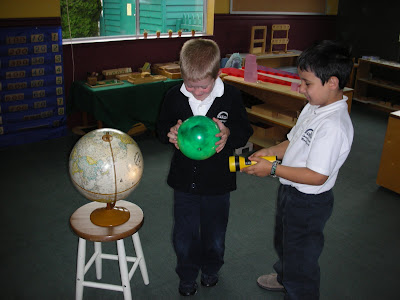 children work with globes things to love about first day of school NAMC montessori classroom