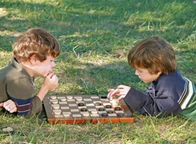 NAMC montessori education work and play boys playing checkers
