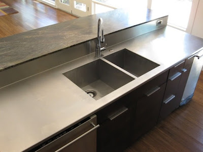 Stainless Steel Countertop With Integrated Sink And Backsplash