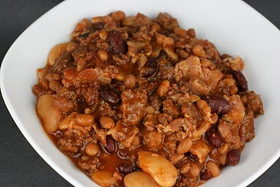 Potluck Beans from A Year of Slow Cooking. These are the BEST BEANS EVER. The recipe has bacon, brown sugar, liquid smoke, ground beef or turkey, and a few different kinds of beans. YUM.