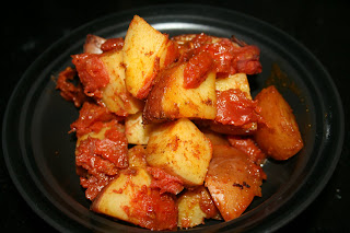 This is a fun side dish when you're bored of plain old potatoes: toss them with olive oil, paprika, curry, and chili powder and throw into the crockpot!