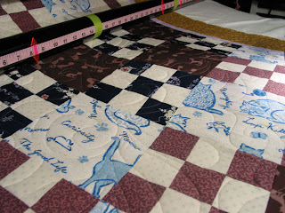 "Quilt with ""swishing cat tail"" design on top, quilted by Angela Huffman"