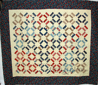 Anna's folksy Patriotic quilt with quilting by Angela Huffman - QuiltedJoy.com