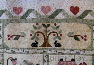 Heart and Home Quilt with custom quilting by Angela Huffman