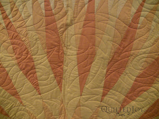 Sunshine Compass Quilt with Flame Curl Pantograph. Edge to edge quilting by Angela Huffman - QuiltedJoy.com