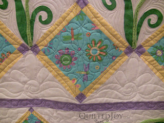 Playful Purple Daisy with custom quilting by Angela Huffman - QuiltedJoy.com