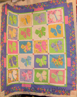 Butterfly Parade with custom quilting by Angela Huffman - QuiltedJoy.com