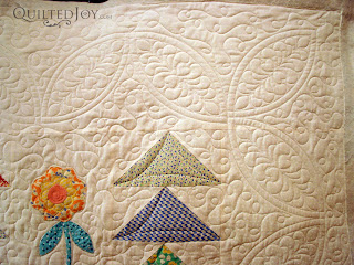 Flying Geese Garden with custom quilting by Angela Huffman - QuiltedJoy.com