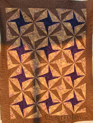 Sarah's Purple Pinwheels, quilted by Angela Huffman