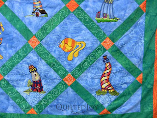 Fay's Lighthouse & Fish Embroidery Quilt, quilted by Angela Huffman