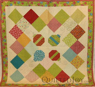 Christmas quilt with Moda Fabrics, quilted by Angela Huffman