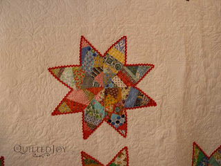 Scrappy Stars Quilt with custom quilting by Angela Huffman - QuiltedJoy.com