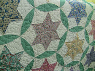 Stars with Modified Prairie Point Border with custom quilting by Angela Huffman - QuiltedJoy.com