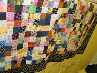 Postage Stamp Quilt on the APQS Millie - QuiltedJoy.com