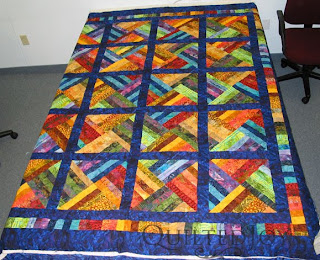 Luscious Batik Strip Quilt with Pretty Posie Panto, edge to edge quilting by Angela Huffman - QuiltedJoy.com