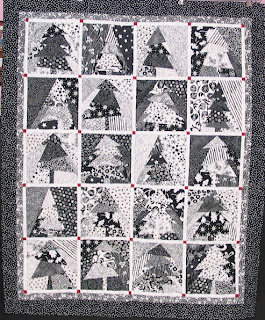 Modern Christmas tree wall hanging with a great graphic contrast! Longarm quilting by Angela Huffman - QuiltedJoy.com