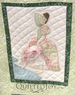 August block in a Hankie Lady Obsession Quilt with custom quilting by Angela Huffman - QuiltedJoy.com