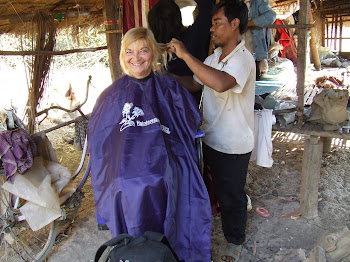 Lisa Gets haircut from Landmine Survivor Vit Thoun