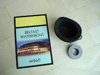 Monopoly card lying on floor from Belfast edition - Waterfront Hall