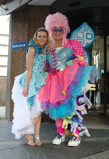 Cinderella (Alana Kerr) and the Dame (Dan Gordon) posing outside the Waterfront