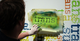 Adam Turkington doing a spot of street art at the launch of Trans Festival 2010