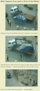 Car being clamped and towed away in front of the Belfast Hilton hotel in April 2008