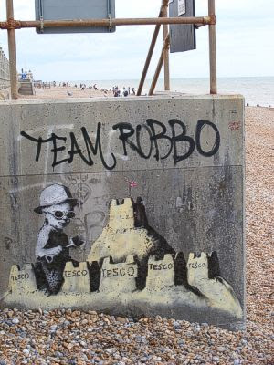 Banksy with shingle beach in background