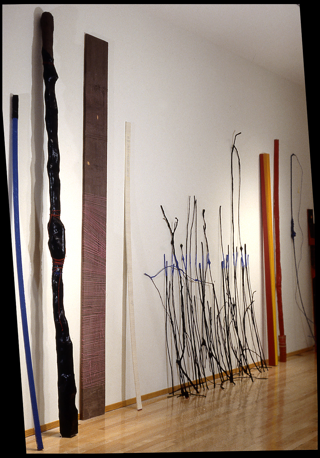 Family and Friends, 1999. tape & string on wood and various materials, tallest at 11 feet.